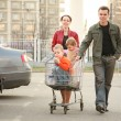 Family on shop parking — Stock Photo #3541059