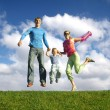 Fly happy family on blue sky with clouds — Stock Photo #3541116
