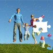 Fly happy family puzzle — Stock Photo