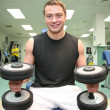 Gym man with dumbbell 4 — Stock Photo