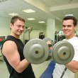 Gym boys with dumbbells — Stock Photo