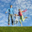 Fly happy family on blue sky — Stock Photo
