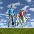 Fly happy family on blue sky with clouds — Stock Photo
