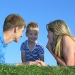 Family of three on grass — Stock Photo