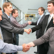 Shaking hands business partners — Stock Photo