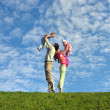 Family with two children under cloudfield — Stock Photo