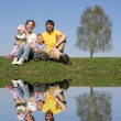 Family with birch and water — Stock Photo