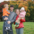 Autumn family of four — Stock Photo