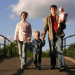 Family on bridge — Stock Photo