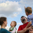 Family and sky — Stock Photo