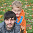 Autumn child with father — Stock Photo