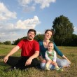 Family with baby on meadow and trees 2 — Stock Photo #3541314