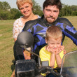 Family on bike — Stock Photo