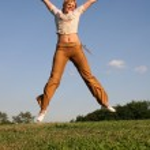Jump girl on meadow — Stock Photo