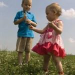 Children on meadow — Stock Photo #3541376