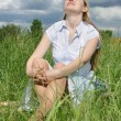 Woman sit on grass after storm — Stock Photo