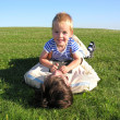 Son lie on father on green grass 2 — Stock Photo #3541484