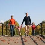 Family of four on bridge — Stock Photo