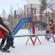 Winter family on seesaw — Stock Photo
