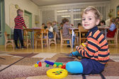 Child play in kindergarten — Stock Photo