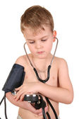 Child with sphygmomanometer — Stock Photo
