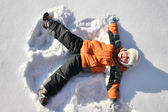 Boy lies on north pole snow — Stock Photo