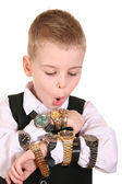 Boy with many clocks — Stock Photo