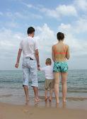 Back family of three. beach. — Stock Photo