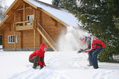 Couple winter house throw snow — Stock Photo