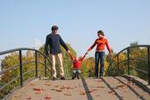 Family with boy on bridge — Stock Photo