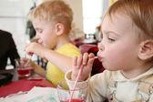 Children drinking — Stock Photo