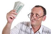 Senior with money — Stock Photo