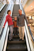 Family on elevator shop — Stock Photo
