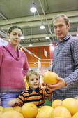 Family and orange — Stock Photo