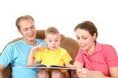 Family with boy read book — Stock Photo