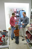 Parents with child in shop — Stock Photo