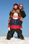 Winter family stand on snow 2 — Stock Photo