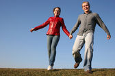Running couple with natural light — Stock Photo