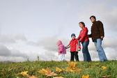 Autumn family of four — Stock Photo