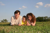 Family lies on meadow — Stock Photo
