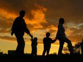 Familie van vier zonsondergang 3 — Stockfoto
