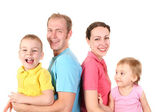 Color shirts family of four — Stock Photo