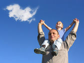 Grandfather and grandson with cloud — Stock Photo