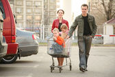 Family on shop parking — Stock Photo