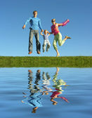 Fly happy family and water — Stock Photo