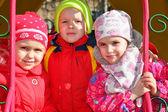 Garçon avec des filles à l'école maternelle — Photo