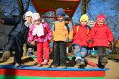 Team with leg up in kindergarten — Stock Photo