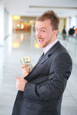 Happy businessman with dollars — Stock Photo
