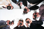 Paparazzi under victim — Stock Photo