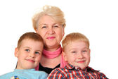 Grandmother with hooligans grandchildren — Stock Photo